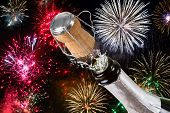 image of champagne color  - New Years celebration with bottle of champagne - JPG