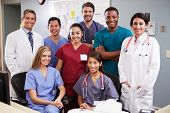 picture of scrubs  - Portrait Of Medical Team At Nurses Station - JPG