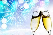 foto of congrats  - Glasses with champagne against fireworks - JPG