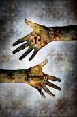 image of unexplained  - Hand holding a key alongside second hand holding a jigsaw piece with keyhole in centre against a grunge background of layered jigsaw pieces denoting mystery - JPG