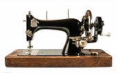 stock photo of sewing  - Vintage sewing machine white isolated studio shot - JPG