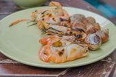 stock photo of babylon  - grilled spotted babylon and shrimps on dish - JPG