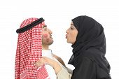 stock photo of irresistible  - Arab saudi obsessed woman kissing desperately a man isolated on a white background - JPG