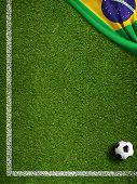 stock photo of football pitch  - Soccer field with ball and flag of Brazil - JPG