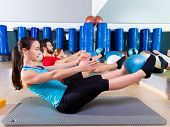 foto of softball  - Pilates softball the teaser group exercise at fitness gym - JPG