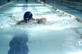 picture of swim meet  - Professional male swimmer swimming in the pool - JPG