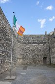 stock photo of execution  - Flag of Ireland in Kilmainham prison where prisoners were executed - JPG