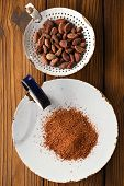 foto of cocoa beans  - cocoa powder and roasted cocoa chocolate beans in old enamel sieve - JPG