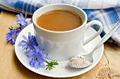 picture of chicory  - Chicory drink in a white cup with a flower and a spoon on the saucer - JPG