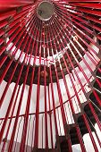 stock photo of spiral staircase  - Red metal spiral staircase in tall tower - JPG