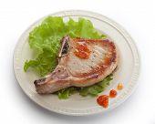 stock photo of pork cutlet  - Fried pork cutlet with fresh green lettuce on the plate - JPG