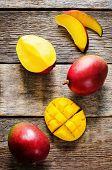 stock photo of mango  - mango on a dark wood background - JPG