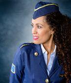 picture of flight attendant  - Attractive woman Flight attendant Smiling dressed in blue uniform - JPG