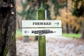 stock photo of opposites  - Rural signboard with two signs saying  Forward  - JPG