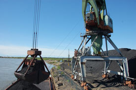 picture of coal barge  - Crane loading coal to ship at Kolyma river port Zyryanka Yakutia region Russia - JPG
