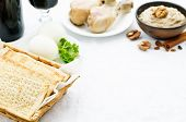 stock photo of matzah  - Matzah wine eggs chicken greens and haroset on a white background traditional food for the Pesach - JPG