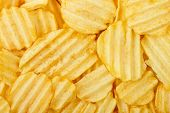 image of potato chips  - closeup of potato chips for background use full frame - JPG