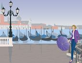 stock photo of wet pants  - the girl with the umbrella in Venice in front of gondola - JPG