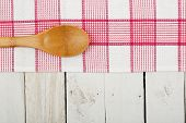 stock photo of ladle  - napkin and wooden ladle on white planks - JPG