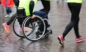 foto of disability  - disabled athlete with the wheelchair during a competition - JPG