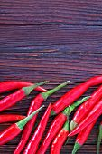 image of chillies  - chilli peppers on the wooden table hot chilli - JPG