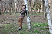 foto of early-man  - young man poses in the early spring in a park. ** Note: Shallow depth of field - JPG