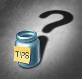 image of money  - Tip jar symbol and tipping questions concept as a gratuity container with money inside casting a shadow shaped as a question mark as an icon for deciding how much money to give for service - JPG