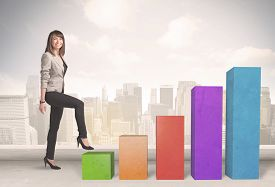 foto of climb up  - Business person climbing up on colourful chart pillars concept on city background - JPG
