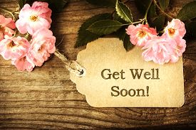image of sympathy  - Get Well Soon message card with small roses on wood background - JPG