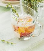 foto of serving tray  - Cool fruity cocktails soda water served on a wooden tray decorated with flowers raspberries sliced nectarine and sprigs of thyme - JPG
