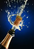 stock photo of special occasion  - champagne splash - JPG