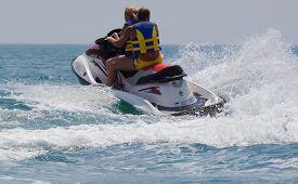 pic of waverunner  - Young Man and girl on Jet Ski - JPG