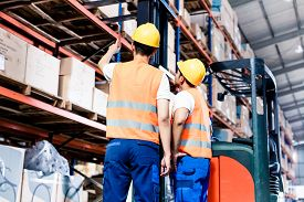 foto of warehouse  - Worker team taking inventory in logistics warehouse - JPG