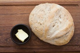 stock photo of home-made bread  - home made bread and butter on wooden board  - JPG
