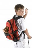 stock photo of bagpack  - boy is saying goodbye and walked away - JPG