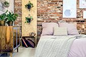Industrial Bedroom With Pink Bedding poster