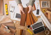Interior Designer Choosing A Baseboard poster
