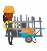 African female builder with thumb up standing near wheelbarrow. Builder in hard hat giving thumb up. poster