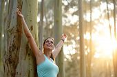 Blissful Sporty Woman Enjoying Freedom In Nature. poster
