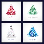Set of four beautiful christmas cards with abstract trees.