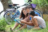 foto of family vacations  - Family on bicycle ride in the countryside - JPG