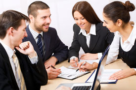 stock photo of business meetings  - Business people in a work meeting in the office - JPG