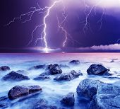 stock photo of lightning bolts  - summer storm beginning with lightning - JPG