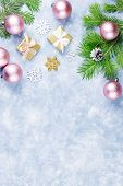 Festive Christmas Background With Fir Branches, Giftboxes, Silver And Golden Decorations, Copy Space poster