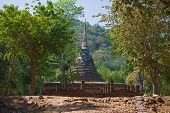 Chedi Of The Ancient Buddhist Temple Wat Chedi Ngarm On A Sunny Day. Thailand, Sukhothai poster