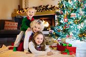 Child At Christmas Tree. Kids At Fireplace On Xmas poster