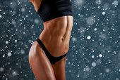 Beautiful Super Fit Young Woman Showing Off Her Perfect Muscular Ripped Abs. Fitness Model. Perfect  poster