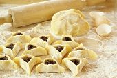 stock photo of purim  - Preparing cookies with poppy seed filling  for Purim  - JPG