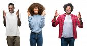 Collage of african american group of people over isolated background smiling crossing fingers with h poster