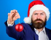 Man Bearded Hipster Wear Formal Suit And Santa Hat. Special Christmas Offer. Santa Hold Christmas Ba poster